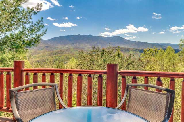 table and chairs on deck with smoky mountain view